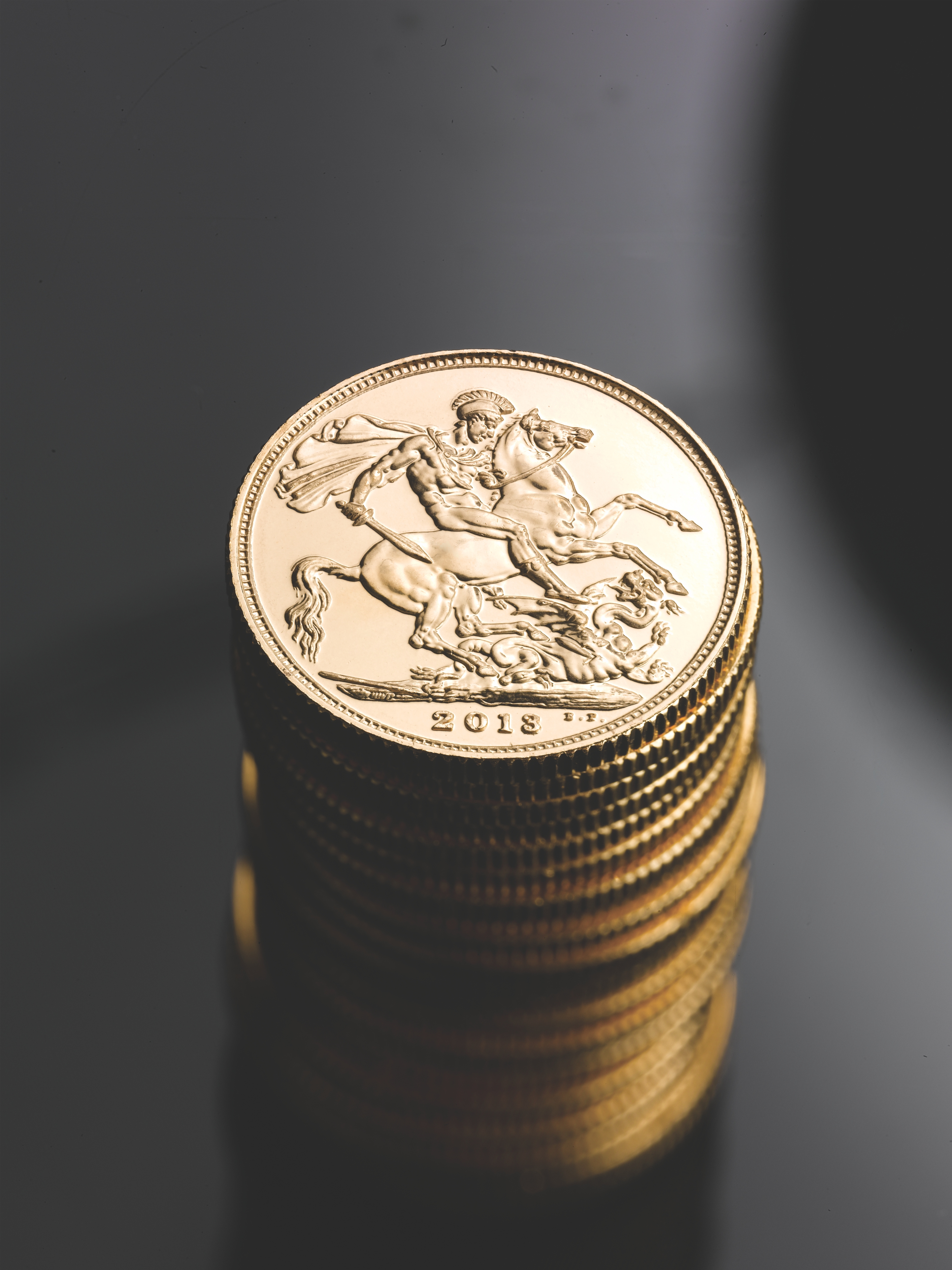 British Gold Sovereign Coins Stacked